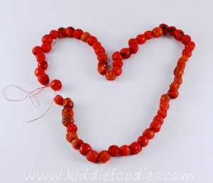 DIY rowanberry necklace - fine motor skills activity for kids step3a
