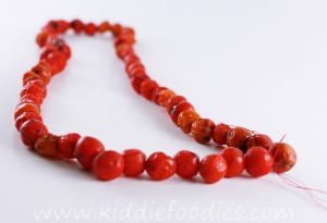 DIY rowanberry necklace - fine motor skills activity for kids step3c