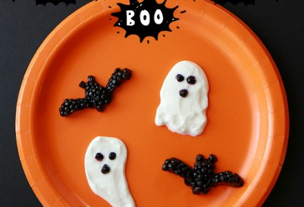 Spooky Halloween dessert - ghosts, bats made from yogurt and blackberries
