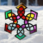 Suncatcher snowflake craft for kids